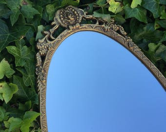 Stunning oval portrait mirror vintage ornate mirror with metal frame - made in England.
