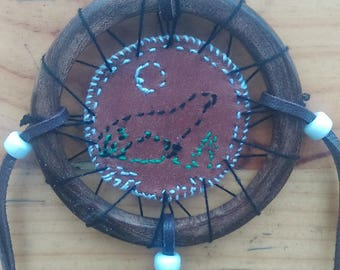Mandala Native American Wolf howling at Moon leather, wood, cotton, glass beads, and natural feathers