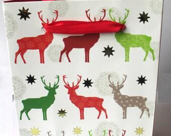 1 pocket, White Christmas gift bag has 12 Christmas Reindeer pattern x 15 5x6.8cm