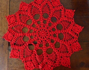 Red round crochet doily
