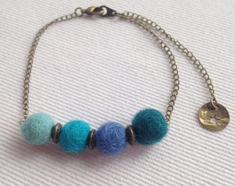 Boho chic bracelet blue felted wool ball and gold metal