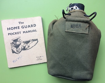 Vintage water canteen and home guard pocket book , british army canteen , army canteen , home guard pocket book , military items