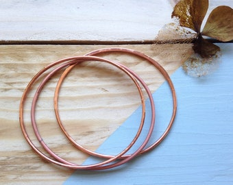 Copper bangle trio | Handmade stacking bangles in pure copper, each one with a different finish | Recycled packaging | Brighton UK.