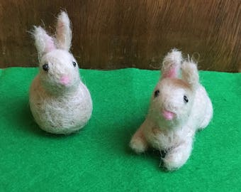 Cute Needle-Felted Easter Bunny Sitting Up Or Lying Down In Light Beige, White Tail And Black Bead Eyes