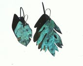 Asymmetrical leaf earrings with patina
