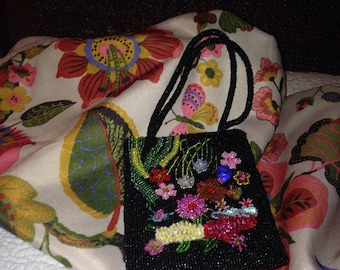 Vintage black small beaded purse decorated with many more colorful beads with handle