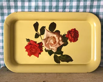 yellow metal tray with roses