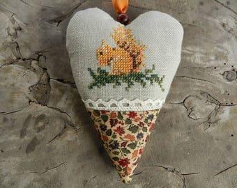 Textil squirrel  heart, Cross stitch ornaments, Fall heart decor, Finished cross stitch ornaments