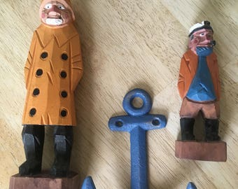 Hand carved wood fishermen and cast iron anchor