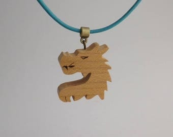 dragon in cherry wood and leather pendant
