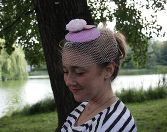 Fascinator purple with veil, pink Ranunculus a leaf and Pink Ribbon