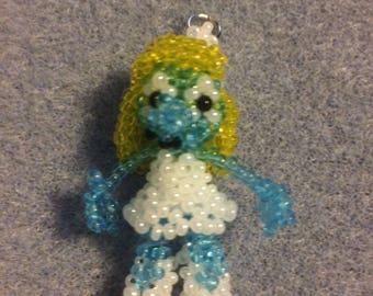 Smurfete doll pendant.
