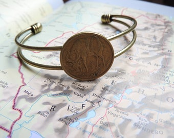 Ethiopia coin cuff bracelet - 2 different designs - made of original coins from Africa - lion - antilope - travel gift