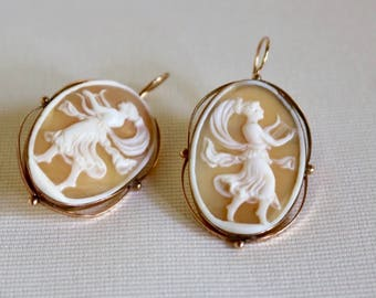 """Pair of 10k gold carved shell cameo earrings. Neoclassical female figures playing lutes Approximately 1 5/8"""" x 1""""."""