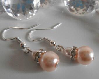 Rhinestone wedding earrings and pale pink beads