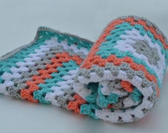 Aqua and orange crochet baby blanket