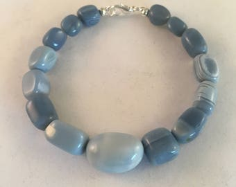 Beaded bracelet. Bracelet is made from graduating blue opal nuggets with the largest bead in the middle of the bracelet, with a toggle.
