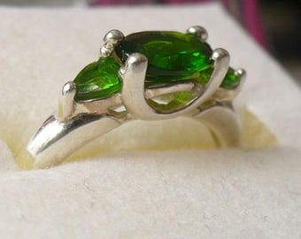 Sterling silver ring with green gemstones, size 7