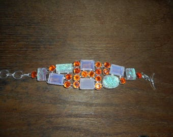 A crystal orange and pink opal glass toggle bracelet