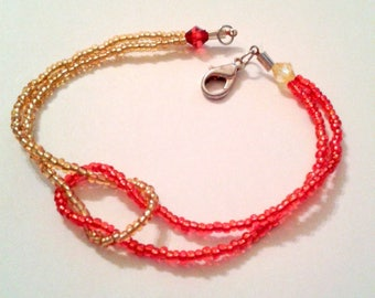 Cross bracelet red and gold seed beads