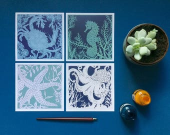 Set of 4 sea creature greetings cards of an octopus, crab, starfish and seahorse.