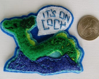 "Eco-Felt Hand Sewn ""It's on Loch'"" Nessie Pin"