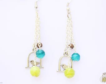 Dangling Silver earrings with charm bird and beads