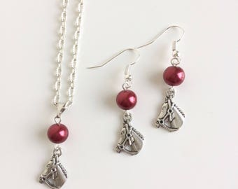 Adornment necklace and earrings, horses and red beads