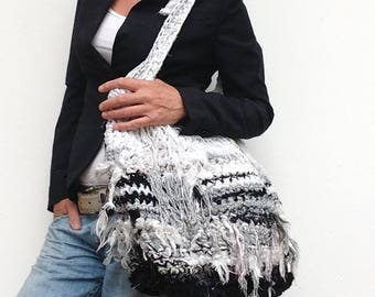 Handmade durable bag of recycled strips of fabric and knitting wool to wear on both sides. Crocket bag with fabric strips