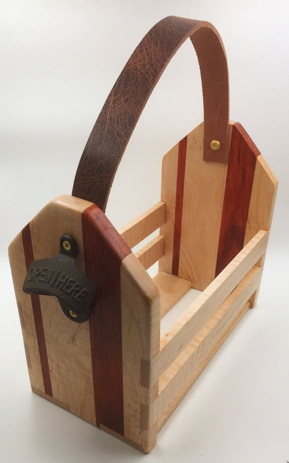 6 pack beer caddy. Maple and Padauk wood, with leather handle. Bottle opener built in!