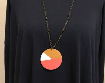 Wooden necklace in coral