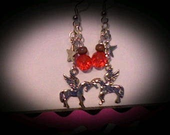 Pegasus earrings sliver charms w/orange bead accents.