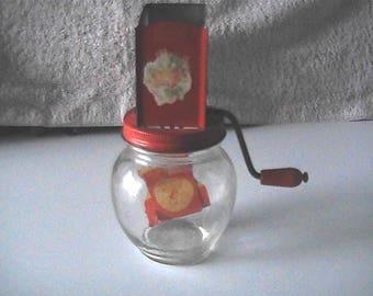 Vintage 1940's Hazel Atlas nut grinder with orange on the spout