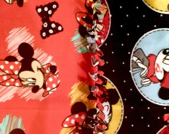 Minnie Mouse Then&Now! Handmade fleece blanket designed by JAX. This Disney theme throw features Minnie Mouse patterns both front and back!