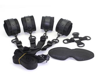 Bondage Black satin under bed restraints, handcuffs, ankle cuffs, 4-way central cross-point and underbed straps, restraints   (mature)