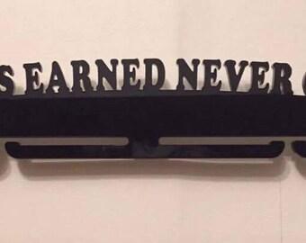 Always Earned Never Given medal holder