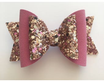 Pink suede and gold glitter bow