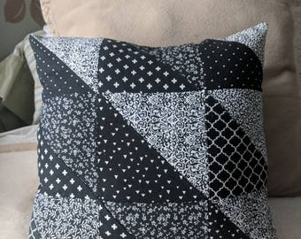 Navy, black, and white accent pillow. Individually pieced, half square triangles in various shades of light and dark patterns.