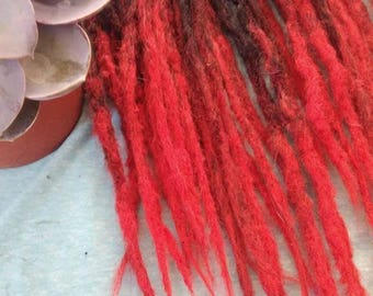 Dreadlocks extensions: Translatives black and red!