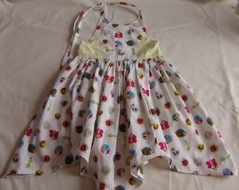 The Alice dress with handkerchief hem and halter neck in a choice of fabrics. Sizes 2-4 years.