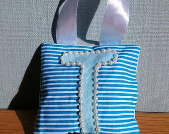 A TURQUOISE stripe tooth fairy pouch door-hanger with BLUE letter, PEARL beaded border, pale blue diagonal pocket on reverse for tooth/coin.