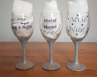 Harry potter themed glitter wine glass, available in purple, black, gold and silver font and any colour glitter you like!