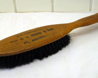Vintage clothes brush from the 1930s 1940s A. J. Bragg & Son St. Austell, Cornwall. Advertising complimentary brush, clothing laundry brush.