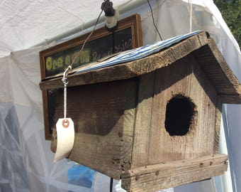 Vintage Bird House with vintage license plate roof.