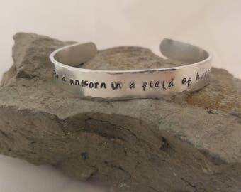 Be a unicorn in a field of horses hand stamped aluminium cuff bracelet.