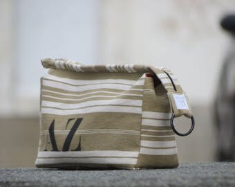 Khaki and white striped mattress ticking bag lined with red cotton