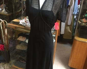 Gorgeous rayon crepe dress of the 1940s featuring sheer ruching and plunging back