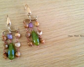 Bronze earrings with peridot. Greenery