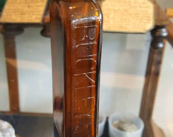 amber colored vintage Buckley syrup bottle