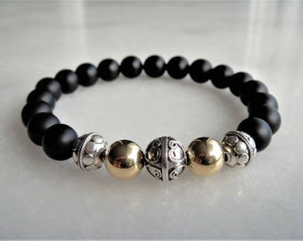 Silver and gold bracelet with matt onyx beads